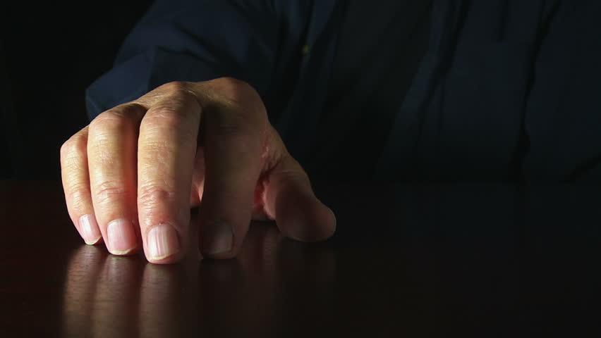 Anxious fingers drum & fidget.